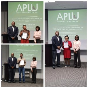 Deputy Public Protector, Adv Kevin Malunga (left) and APLU's Prof Sope Williams-Elegbe (right) hand out certificates.